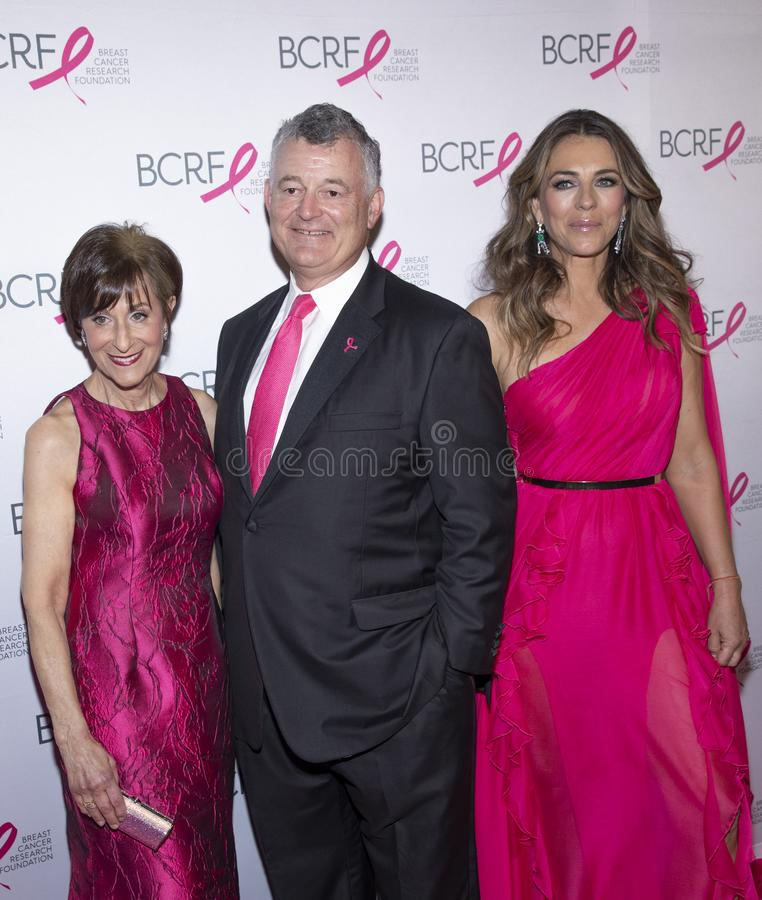 BCRF 2019 Hot Pink Party arrivals. New York, NY, USA - May 15, 2019: BCRF President Myra J. Biblowit, William P. Lauder and Elizabeth Hurley attend the Breast stock photo