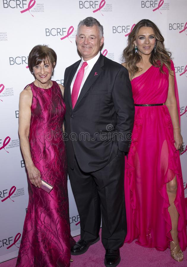 BCRF 2019 Hot Pink Party arrivals. New York, NY, USA - May 15, 2019: BCRF President Myra J. Biblowit, William P. Lauder and Elizabeth Hurley attend the Breast royalty free stock photos