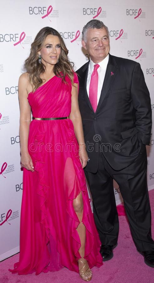 BCRF 2019 Hot Pink Party arrivals. New York, NY, USA - May 15, 2019: Elizabeth Hurley and William P. Lauder attend the Breast Cancer Research Foundation 2019 Hot royalty free stock photo