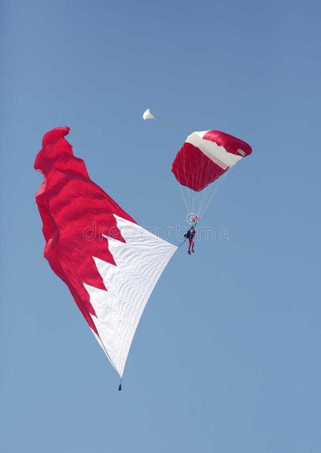 BDF Special Forces Parachute Display Team performs in Bahrain. SAKHIR AIRBASE, BAHRAIN - JANUARY 21: BDF Special Forces Parachute Display Team performs in stock images