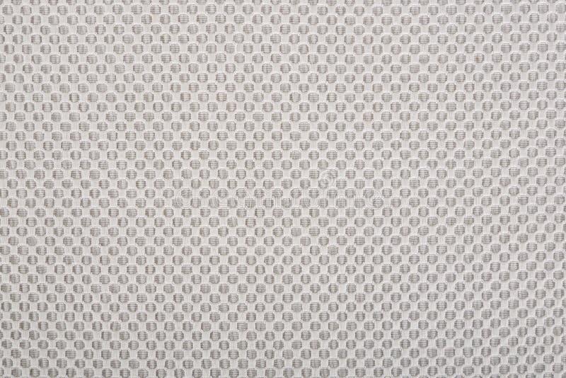 Beżowa tkanina z kropkami, tło. zdjęcia royalty free