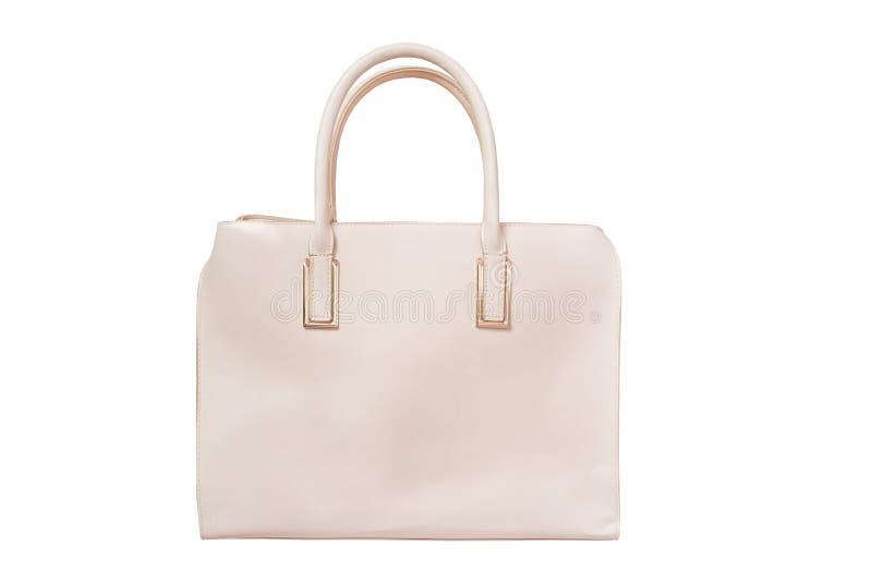 Beżowa torebka modny pojęcie odosobniony Biały tło obraz stock