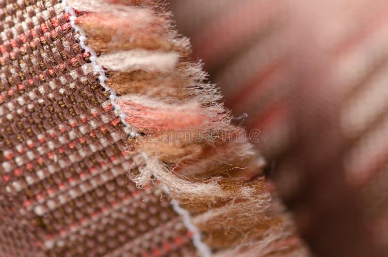 Beżowej brąz tkaniny czerwonej tekstury mody materialny dywan obraz royalty free