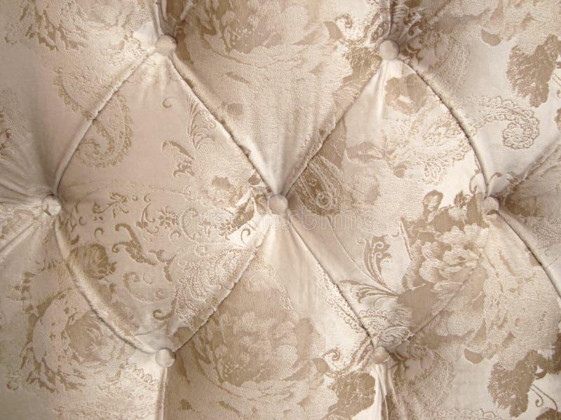 Beżowy weluru tapicerowanie z puszka tłem dla luksusowej dekoracji fotografia stock