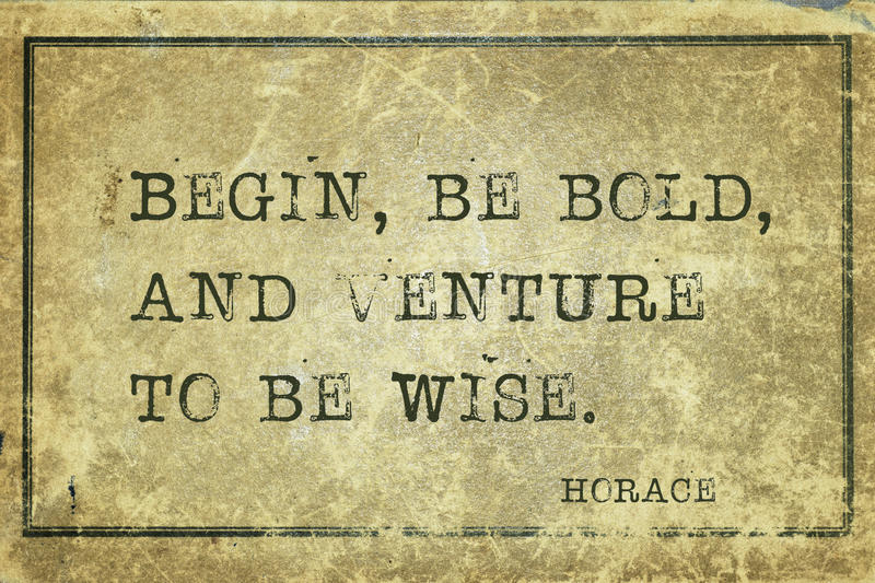 Be bold Horace. Begin, be bold, and venture to be wise - ancient Roman poet Horace quote printed on grunge vintage cardboard royalty free stock images