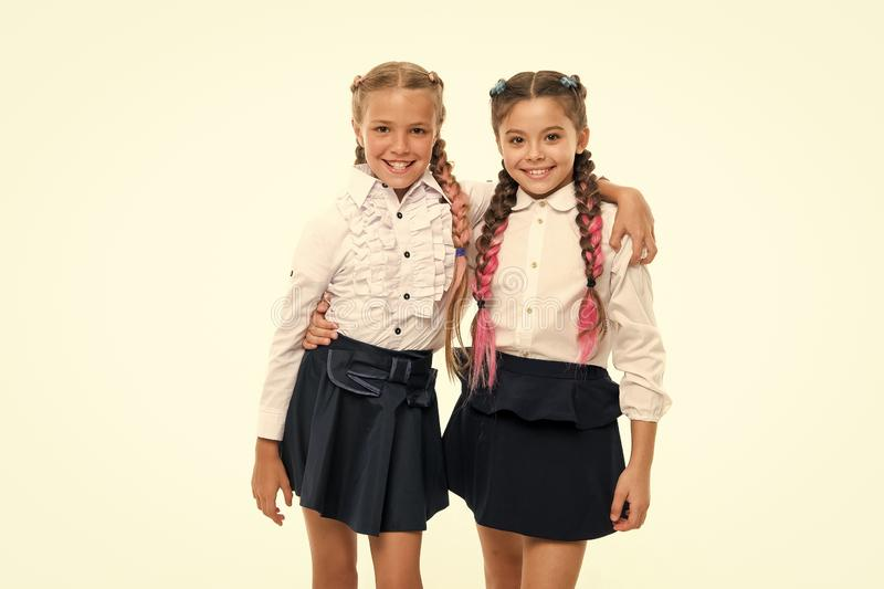 Be bright. School friendship. Sisterhood relationship and soulmates. On same wave. Schoolgirls wear formal school. Uniform. Sisters little girls with braids royalty free stock photography