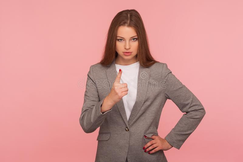 Be careful, caution! Portrait of strict displeased lady boss in business suit making admonishing hand gesture. Warning of problems, teaching and giving advice stock image