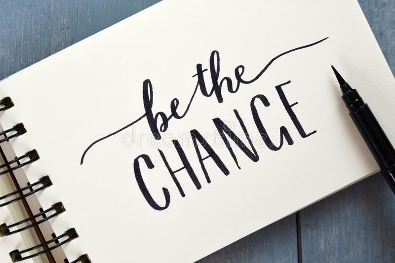 BE THE CHANGE hand-lettered in notepad with brush pen royalty free stock photos