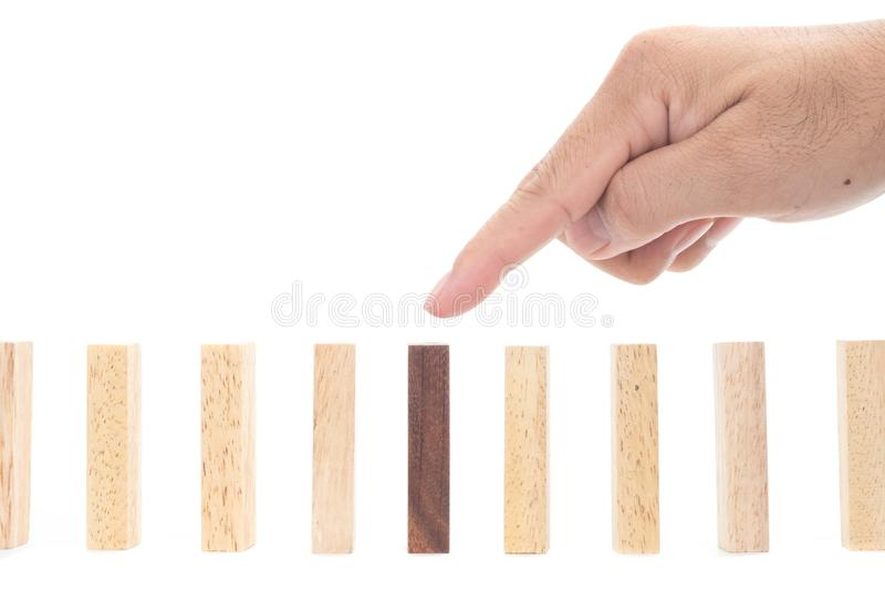 Be different concept. Wooden blocks and a hand on white background, stock photos