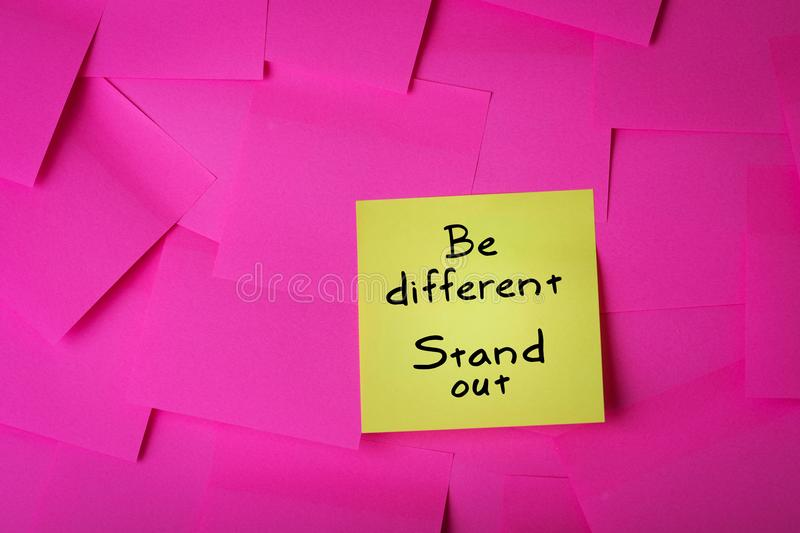 Be different stand out text on sticky note stock image
