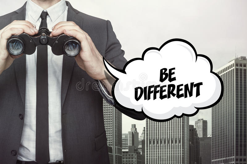 Be different text on blackboard with businessman stock images