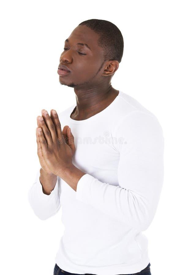 Be för svart man arkivfoto