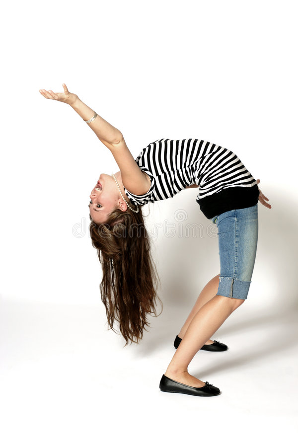 Be Flexible. A teenager bending backwards exhibiting extreme flexibility royalty free stock images