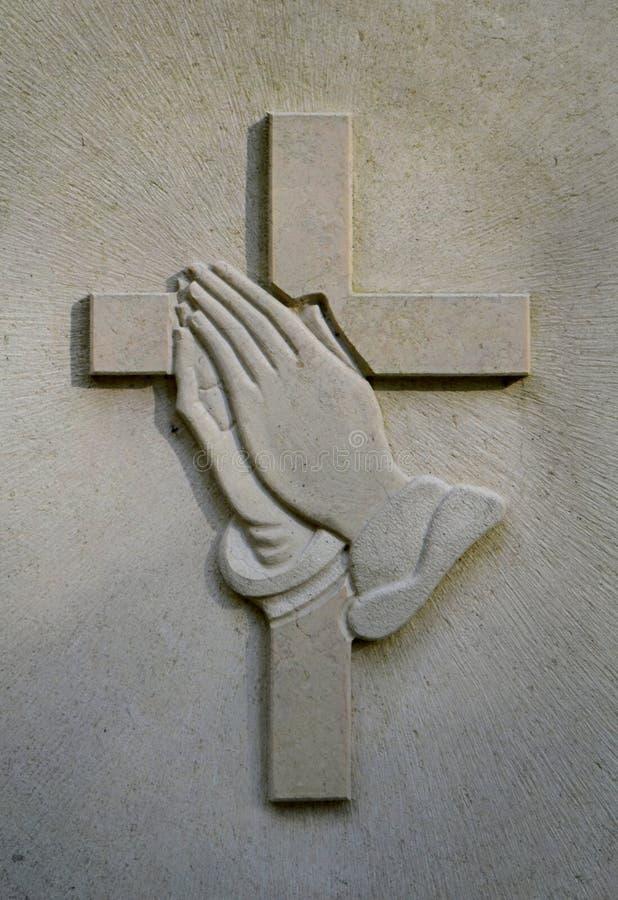 Be händer för kor och Jesuss royaltyfria bilder