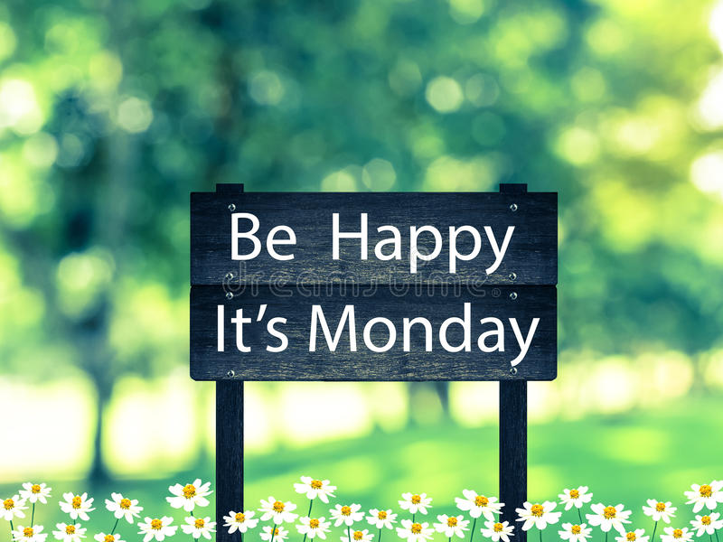 Be Happy ,It's Monday signpost. In beautiful woodland with vintage filter stock image