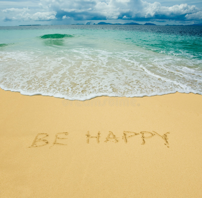 Be happy written in a sand royalty free stock photo