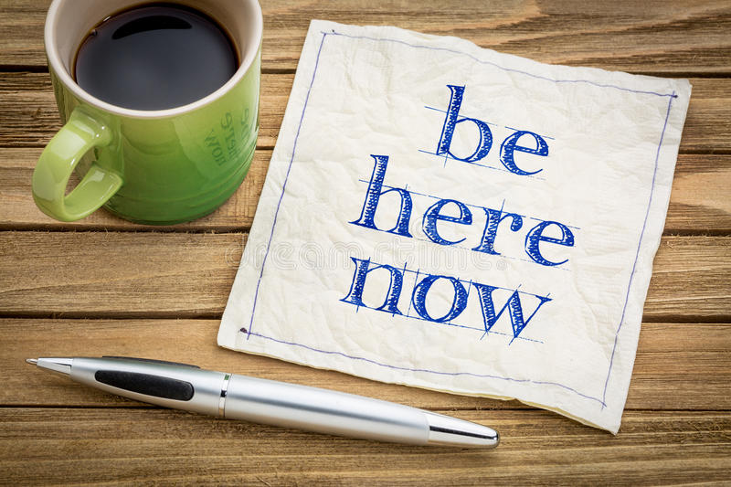 Be here now napkin concept royalty free stock photos