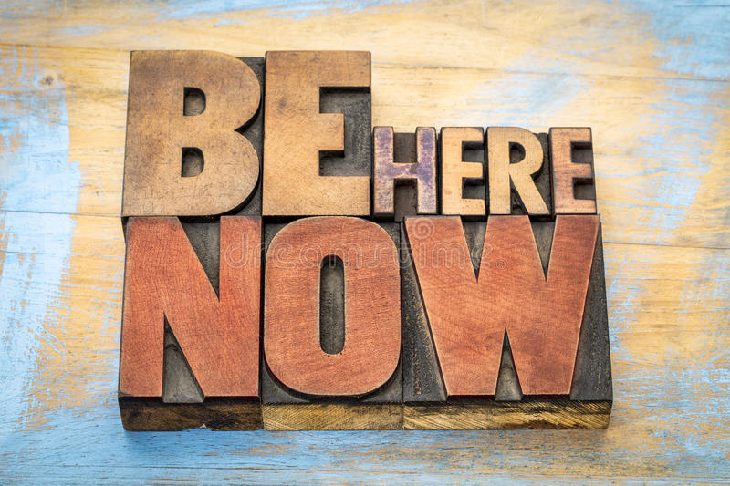 Be here now word abstract in wood type royalty free stock photography