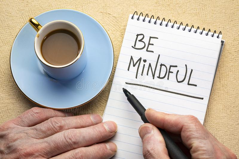 Be mindful - writing a note royalty free stock image