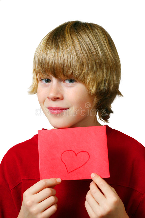 Be Mine. Young boy holds up an envelope with a heart drawn it stock images