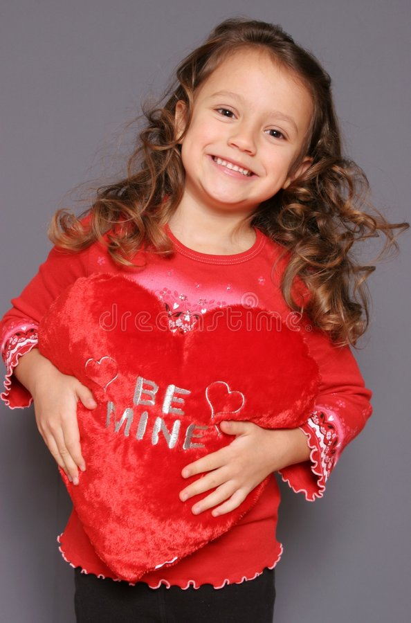 Be Mine. An adorable little girl with her valentine royalty free stock photography