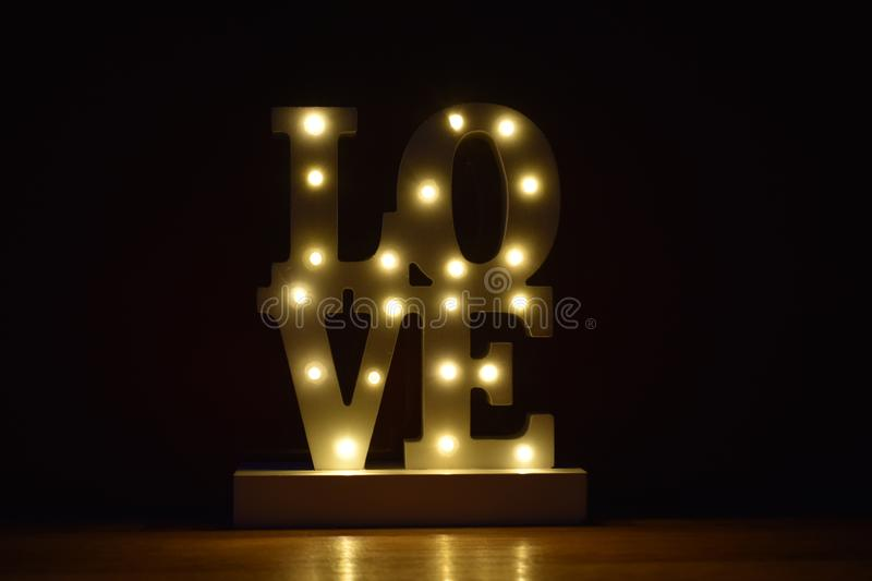 Be my Valenine, Sparkling love, love forever, ray of light,. Light up your love! Let her bloom! An enchanting valentine lamp from the old wood brightens every stock photo