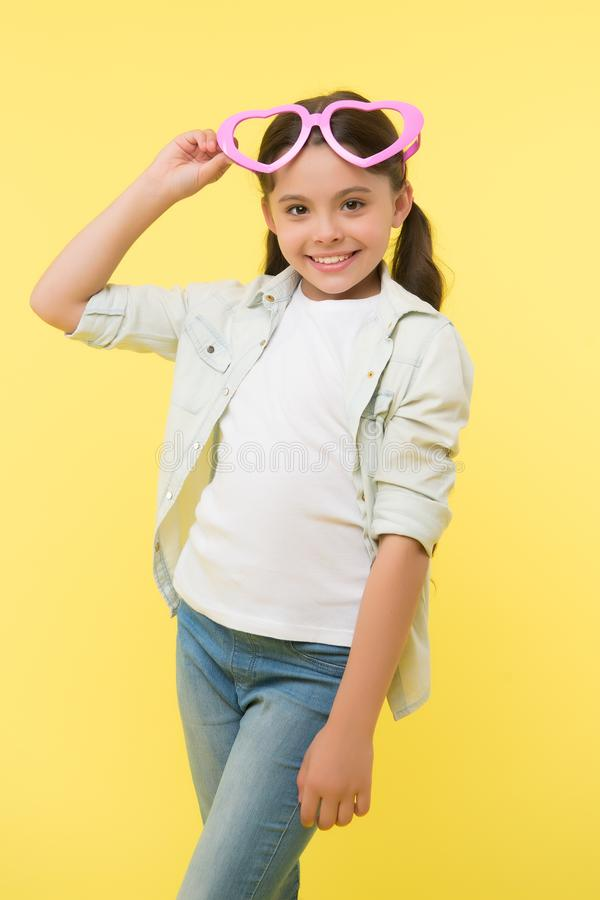 Be my valentine. Child charming smile yellow background. Kid happy lovely feels sympathy. Kid girl heart shaped. Eyeglasses celebrates valentines day. Girl royalty free stock images