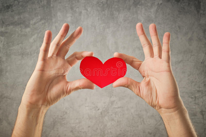 Be my Valentine, Valentines day concept. Man holding red paper heart in his hands royalty free stock photos