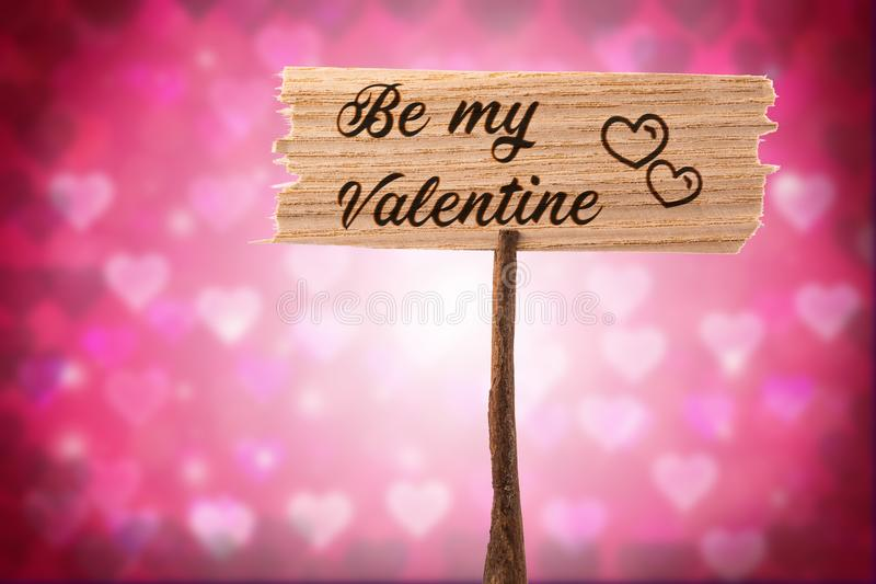 Be my valentine. On wood sign , heart shape background royalty free stock photography