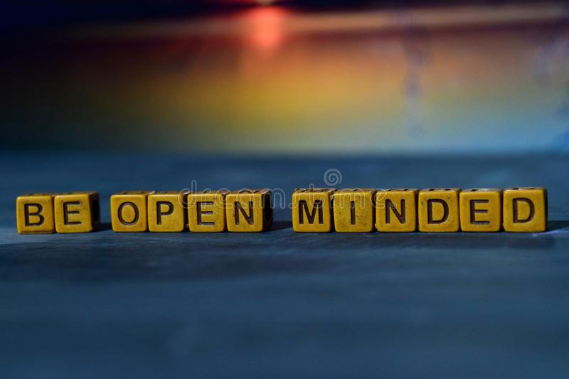 Be open minded on wooden blocks. Cross processed image with bokeh background royalty free stock photography