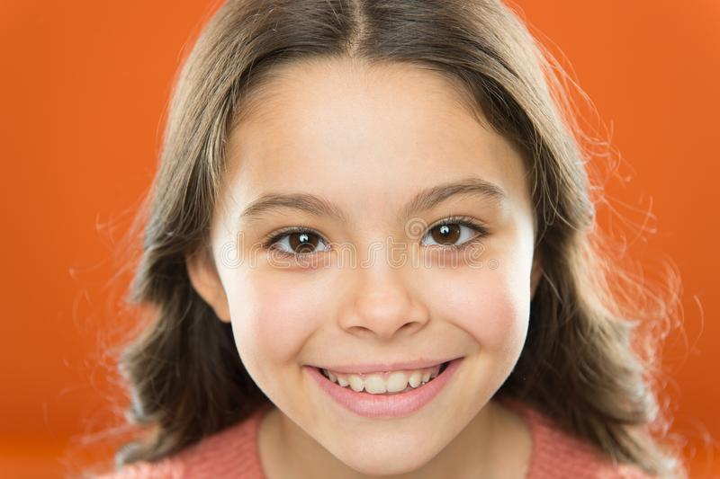 Be positive and keep smiling. Small child with cheerful smiling face. Little girl happy smiling with beauty look. Adorable beauty model with cute smile. Im stock image