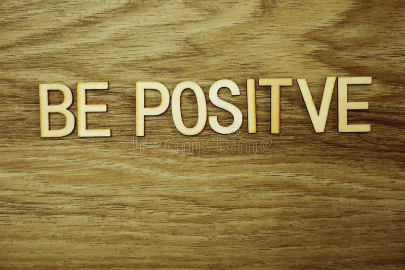 Be Positive text message on wooden background royalty free stock photos
