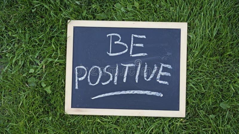 Be positive written stock photos