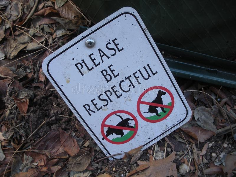 Be Respectful, Curb Your Dog Sign. Please Be Respectful: Sign in New York City asking dog owners to respect urban green space by curbing their dogs. This photo royalty free stock photography