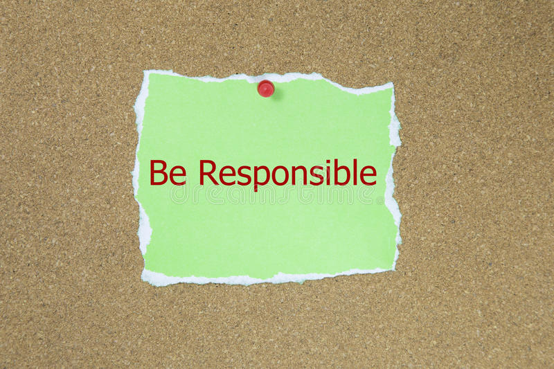 Be Responsible. The phrase Be Responsible in red text on a green sticky note posted to a cork notice board royalty free stock photography