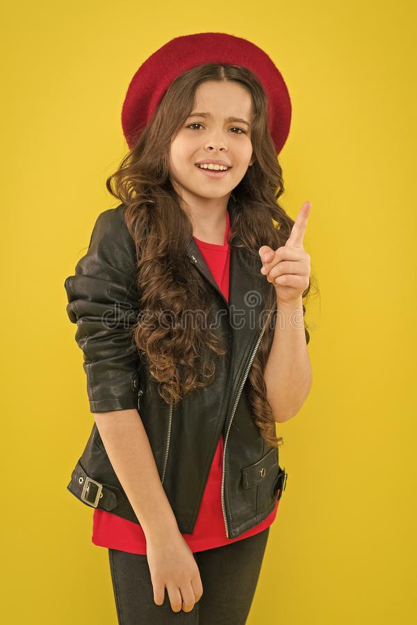 Be simply fashionable. Small girl in fashionable clothes pointing finger on yellow background. Little fashion model with. Fashionable look. Adorable child in royalty free stock photography