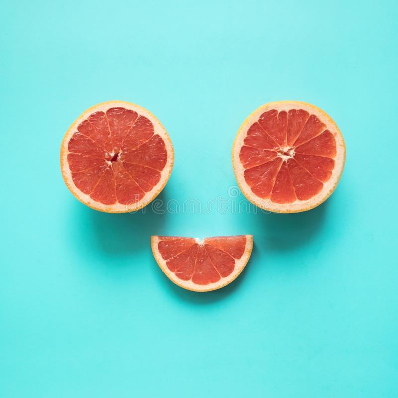 Be smile concepts with red orange food on blue background.summer holiday royalty free stock photo