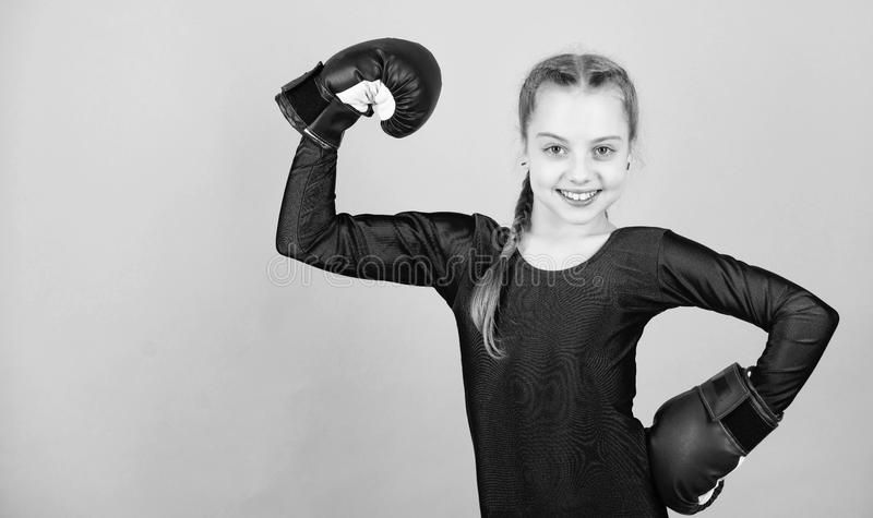 Be strong. punching knockout. Childhood. workout of small girl boxer. Sport success. sportswear fashion. Fitness diet. Energy health. Happy child sportsman in stock photos