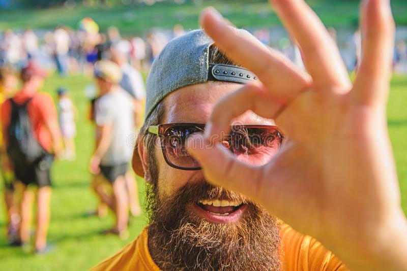 Be sure in your summer vacation. Man bearded in front of crowd riverside background. Book ticket summer festival in. Be sure in your summer vacation. Man bearded stock photography