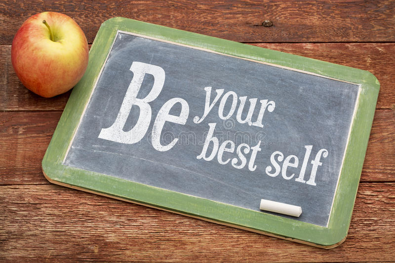 Be your best self. Positive words on a slate blackboard against red barn wood royalty free stock photos
