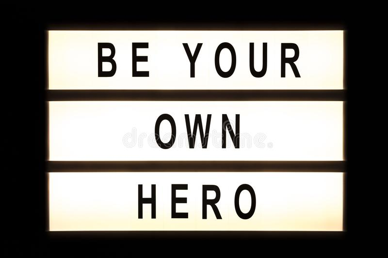 Be your own hero hanging light box royalty free stock photography