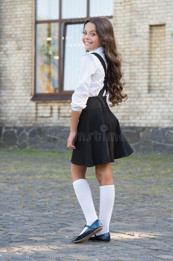Be your own label. old school. back to school. childhood happiness. small happy girl ready to study. uniform market. Smart look. schoolgirl in classy retro stock photography