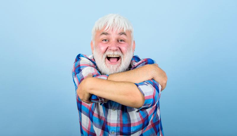 Be yourself. senior man with gray beard. barber and hairdresser. male fashion. mature bearded man in white wig. Hairloss. Concept. health care. happy old granpa royalty free stock images