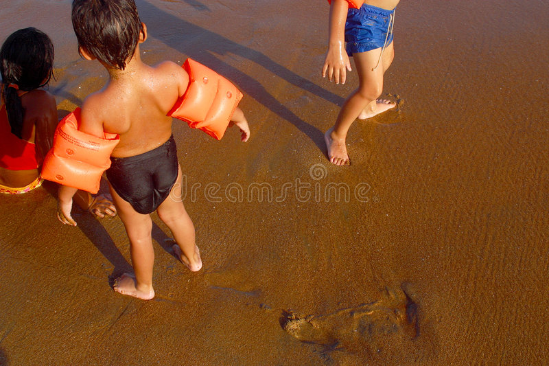 Beach. Shore with kids at the bay of San Agustinillo in the southern state of Oaxaca in Mexico, Latinamerica stock images
