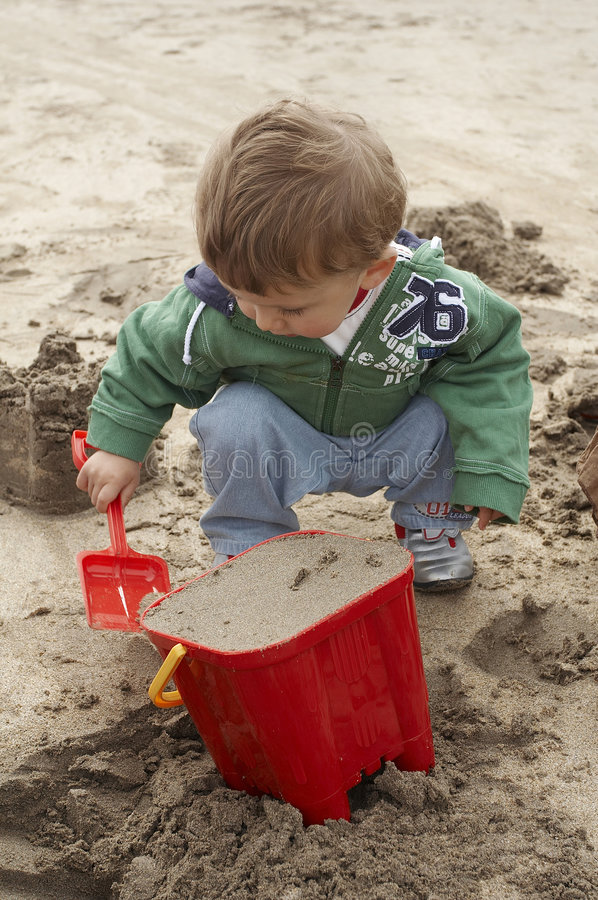 Download Beach stock photo. Image of kids, beach, playing, spade - 861474
