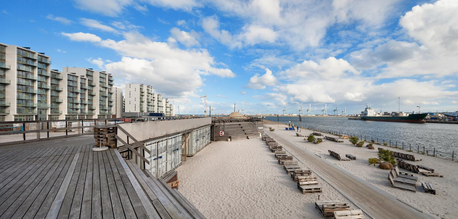 Beach at Aarhus in Denmark. Harbor in the background royalty free stock images
