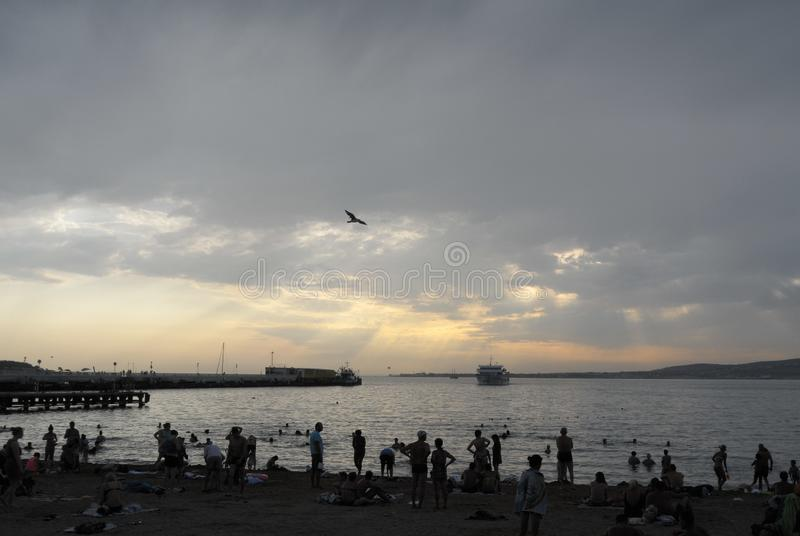 The beach above which hung a storm cloud royalty free stock photography