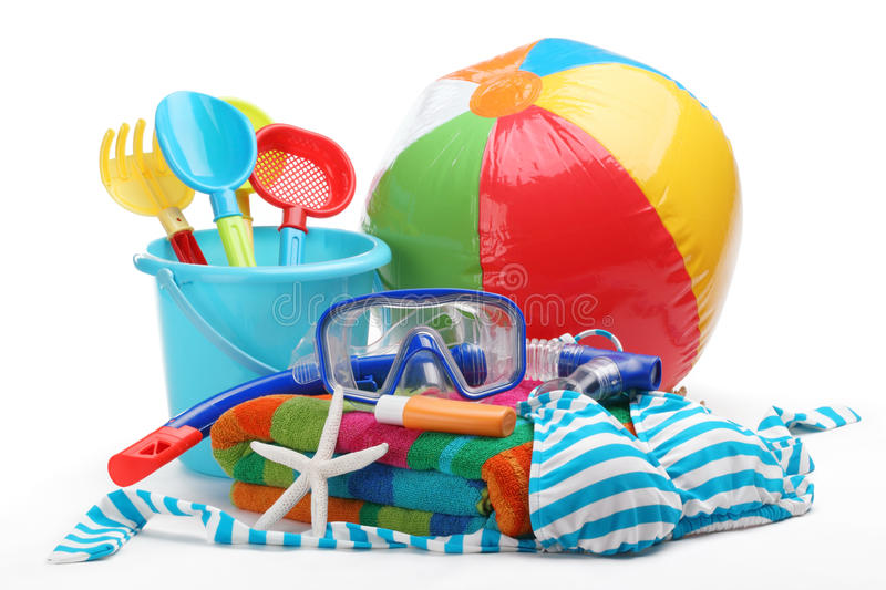 Beach accessories. Plastic toys and diving equipment with swimming suit on white background stock photos