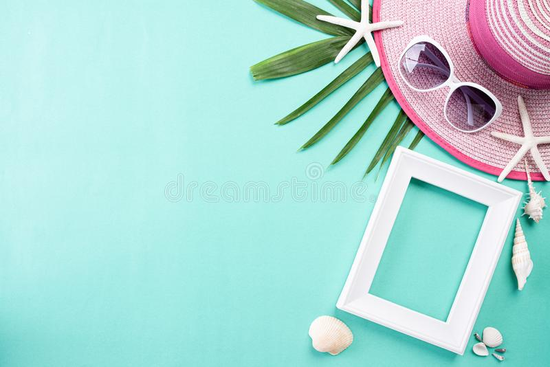 Beach accessories retro film camera, sunglasses, flip flop starfish beach hat and sea shell on green pastel background for summer. Holiday and vacation concept royalty free stock images