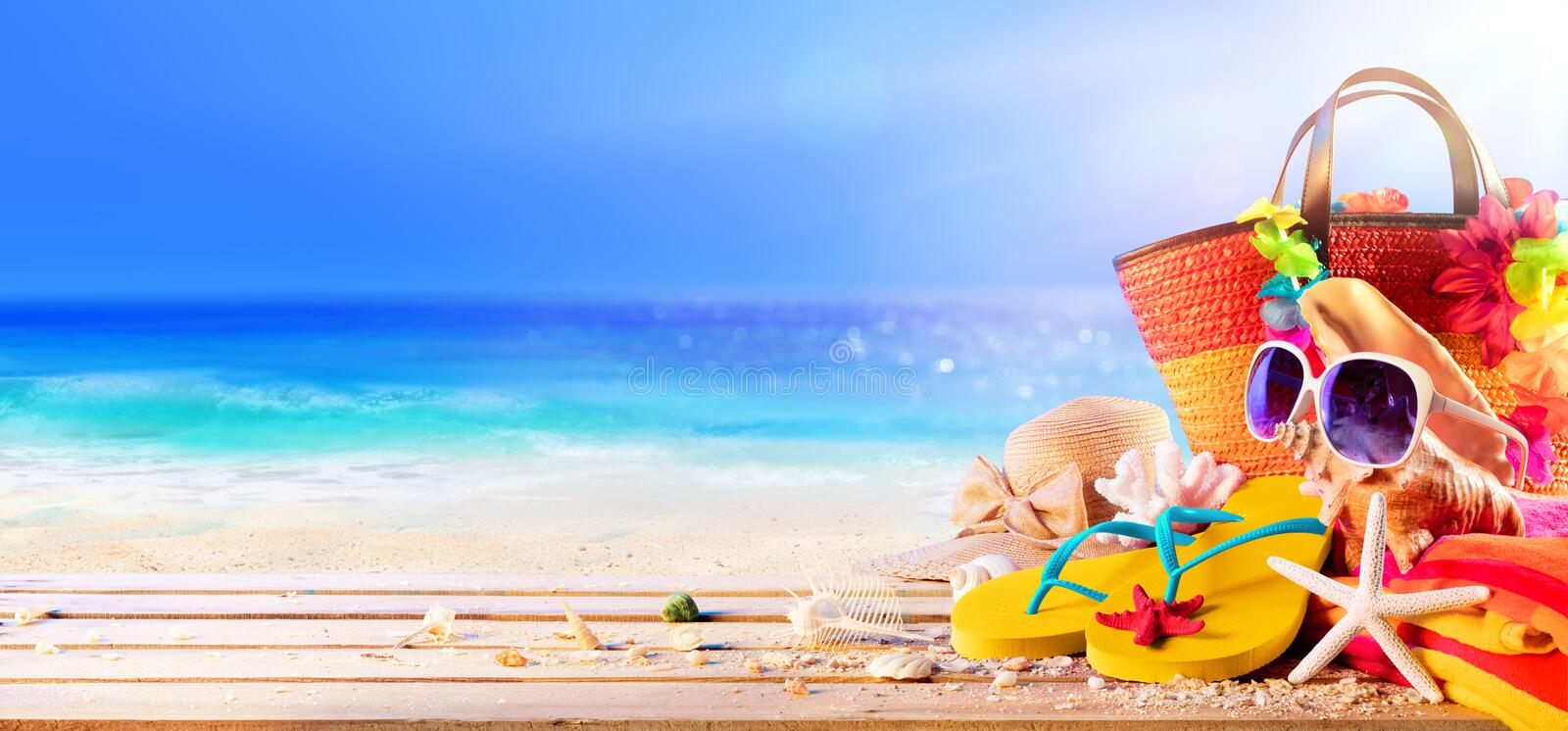Beach Accessories And Shells On Deck In Sunny Seashore. Summer Holidays royalty free stock images